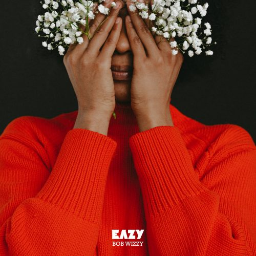 Woman wearing red sweater holding white flowers and covering her eyes. Art work for Eazy Bob Wizzy's Sanctified Baddie